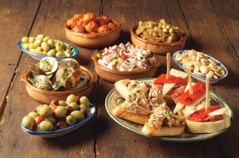 Tapas in Granada...They go overboard and give you a hearty meal! Nothing wrong with that....