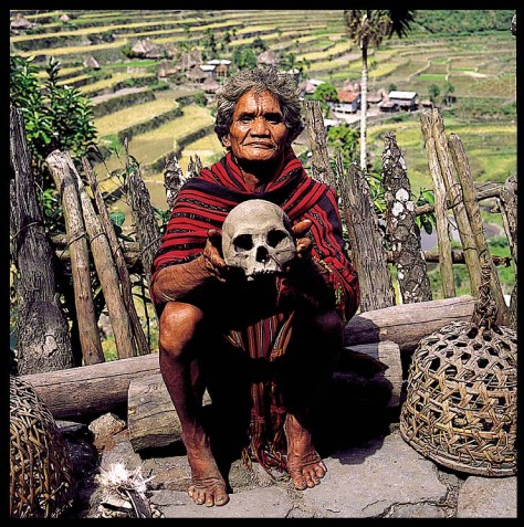 A witch doctor holding a human skull